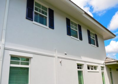 Colonial Shutters combined with Impact Windows from Jupiter Aluminum Products