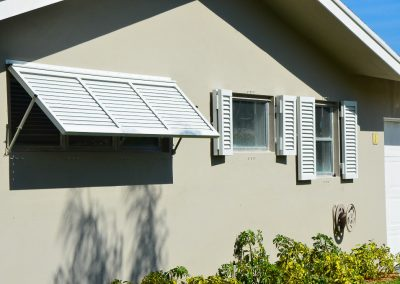 Colonial Shutters combined with Bahama Shutters from Jupiter Aluminum Products