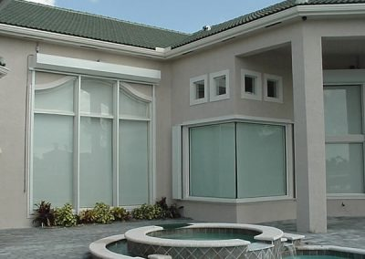 Roll-Up Shutters combined with Accordion Shutters from Jupiter Aluminum Products